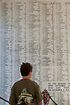 Young boy looking at the Wall of Names at the USS Arizona Memorial, Pearl Harbor, Oahu, Hawaii