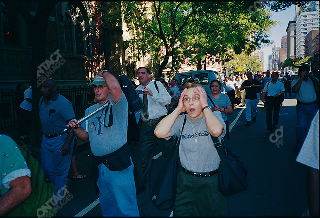 Crowds on 6th avenue in Greenwich Village  react as they see the second tower of the World Trade Center collapse. New York City, USA, September 11, 2001