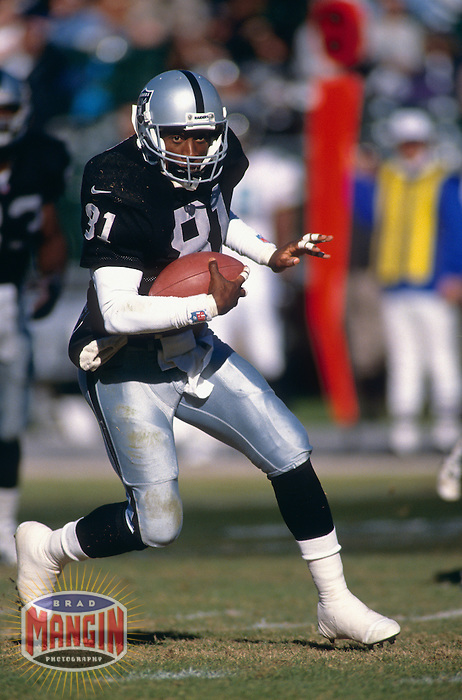 Oakland Raiders wide receiver Tim Brown in action at the Oakland Coliseum in Oakland, CA during the 1997 season. Photo by Brad Mangin.