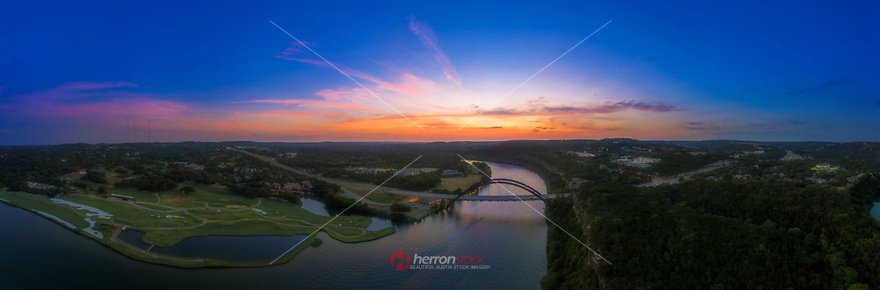 A summer's jewel, the sunset came across Austin Country Club's Golf Course and the 360 Bridge, the gorgeous light of pink and orange hues make for a magical sunset.