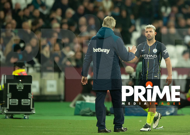 Sergio Aguero of Manchester City and Manuel Pellegrini manager of West Ham United during the Premier League match between West Ham United and Manchester City at the Olympic Park, London, England on 24 November 2018. Photo by Vince Mignott / PRiME Media Images.