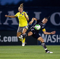 Abby Wambach (20) of the Washington Freedom collides with Nikki Krzysik (15) of the Philadelphia Independence during their game at the Maryland SoccerPlex in Boyds, Maryland.  The Washington Freedom defeated the Philadelphia Independence, 2-0.
