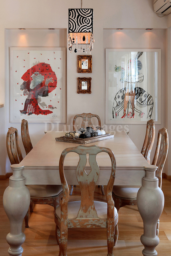 vintage dining table<br /> <br /> A 100 square meter penthouse with a big veranda and contemporary aesthetics located in downtown Athens, Greece.