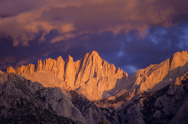 Mount Whitney seen from Owens Valley at sunrise with red clouds, Sierra Nevada, California, USA