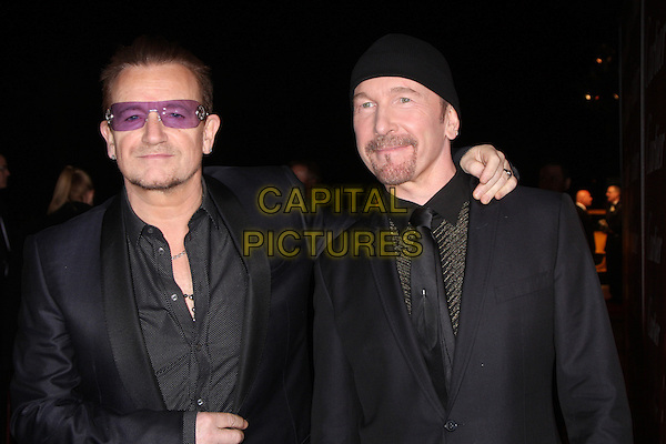 PALM SPRINGS, CA - January 04: Bono, The Edge at the 25th Annual Palm Springs International Film Festival, Palm Springs Convention Center, Palm Springs,  January 04, 2014. Credit: Janice Ogata/MediaPunch Inc.