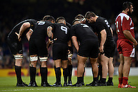 New Zealand players huddle together during a break in play. Rugby World Cup Pool C match between New Zealand and Georgia on October 2, 2015 at the Millennium Stadium in Cardiff, Wales. Photo by: Patrick Khachfe / Onside Images