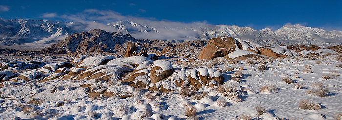 902000029 panoramic view winter sunrise with snow covered granite boulders in the bureau of land management protected land the alabama hills in the southern section of the eastern sierras with lone pine peak  and mount russell in the background in kern county california