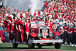 Wisconsin Badgers cheerleaders ride onto the field on the Bucky Wagon prior to an NCAA Big Ten Conference football game against the Maryland Terrapins Saturday, October 21, 2017, in Madison, Wis. The Badgers won 38-13. (Photo by David Stluka)