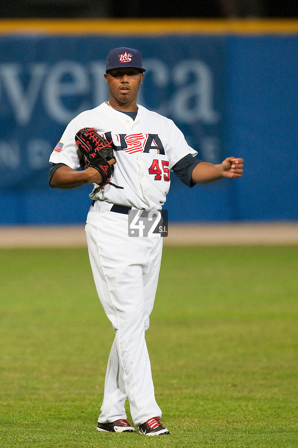 24 September 2009: Trevor Reckling of Team USA warms up prior to the 2009 Baseball World Cup final round match won 5-3 by Team USA over Cuba, in Nettuno, Italy.