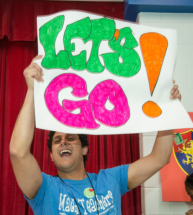 Principal Aaron Dominguez leads a cheer during a pep rally to energize for STAAR testing at Garcia Elementary School, March 27, 2014.