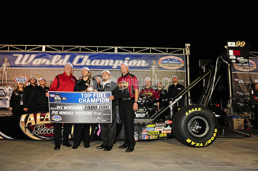 Nov. 13, 2011; Pomona, CA, USA; NHRA top fuel dragster driver Del Worsham celebrates with his crew after winning the 2011 championship and the Auto Club Finals at Auto Club Raceway at Pomona. Mandatory Credit: Mark J. Rebilas-.