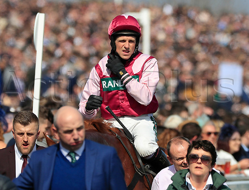 14h April 2018, Aintree Racecourse, Liverpool, England; The 2018 Grand National horse racing festival sponsored by Randox Health, day 3; Harry Skelton on Momella who ran in third in The Betway Mersey Novices' Hurdle