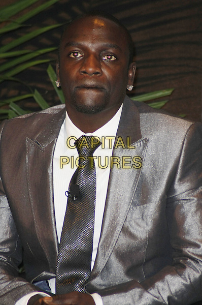 AKON.R&B Star Akon speaks during Billboard's Digital Music Session at 2009 Consumer Electronics Show held at the Las Vegas Convention Center, Las Vegas, Nevada, USA,  7th January 2009..half length grey gray suit silver tie earrings.CAP/ADM/MJT.©MJT/Admedia/Capital Pictures
