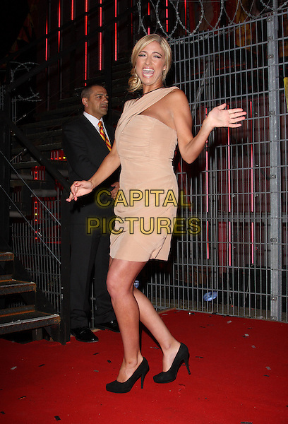 CHANTELLE HOUGHTON .Big Brother 11 Final and Launch night of 'Ultimate Big Brother' at Elstree Studios, Borehamwood, Herts, England, UK, .24th August 2010.full length hand waving nude beige dress one shoulder black shoes heels mouth open  BB11 BB.CAP/ROS.©Steve Ross/Capital Pictures