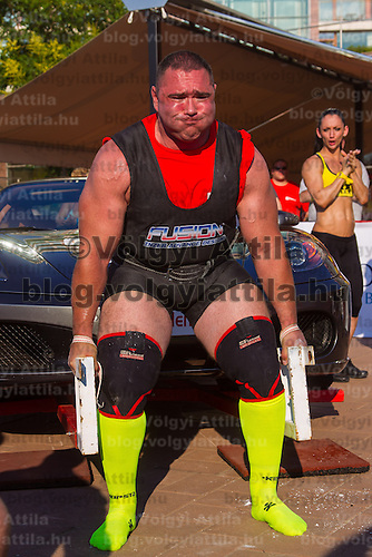 Akos Nagy of Hungary competes in car lifting during the Giants Live Strongman Competition in Budapest, Hungary on June 17, 2012. ATTILA VOLGYI