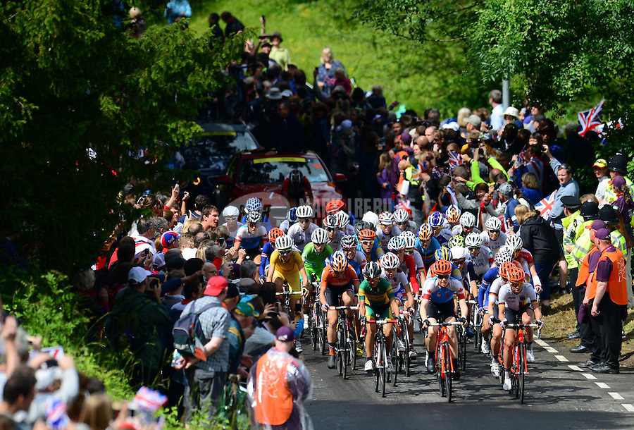 Jul 29, 2012; Dorking, United Kingdom; The peloton of riders race towards Butterfly Bend on Box Hill during the women's cycling race. Mandatory Credit: Mark J. Rebilas-USA TODAY Sports