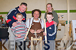 WOODCARVER: The Carroll family Camp learning from Gary Marchan a bit about woodwork at the Camp Childcare Arts & Craft Fair in the Camp Community Centre on Sunday, L-r: Ciara?n,and Noel Carroll, Gary Marchan, Sarah and Aidan Carroll..