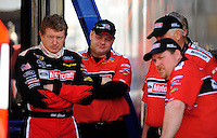 Feb 07, 2009; Daytona Beach, FL, USA; NASCAR Sprint Cup Series driver Bill Elliott (left) with his crew during practice for the Daytona 500 at Daytona International Speedway. Mandatory Credit: Mark J. Rebilas-
