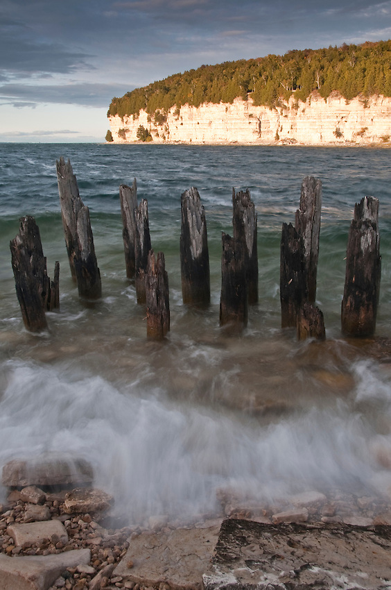 Limestone bluffs and old dock pilings on Lake Michigan at Fayette State Historical Park near Garden Michigan.