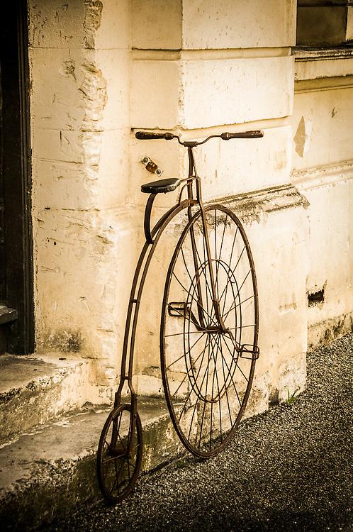 Old Penny Farthing Bike, Oamaru, New Zealand - stock photo, canvas, fine art print