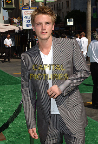 RIELY SMITH.Attending the world premiere of movie New York Minute at The Graumans's Chinease Theatre, Hollywood, California..May 1st 2004.half length half-length pinstripe suit scruffy trainers.*UK sales only*.www.capitalpictures.com.sales@capitalpictures.com.©Capital Pictures