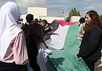 "People march as they hold a large Palestinian flag during an attempt to break the Guinness World Record for the ""largest Palestinian flag"", in the West Bank city of Ramallah October 28, 2014. Photo by Shadi Hatem"