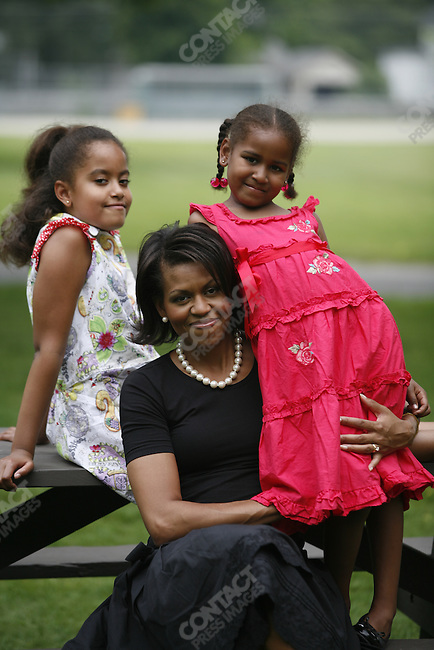 Michelle Obama, wife of Democratic presidential candidate Barack Obama, with her  daughters, Malia (left) and Sasha, visit the New Hampshire Women for Obama Kick-Off Fair in  Concord, New Hampshire, June 2, 2007.