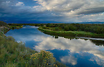 Idaho, Eastern, Driggs, Teton Valley. The Teon River under stoemy skies in late summer.