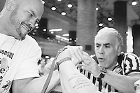 "Richard Calero competes at the Empire State Finals at the Port Authority Bus Terminal in New York City on November 17, 2005.  The Empire State Finals is the culmination in the year of the New York City Arm Wrestling Association's ""Golden Arm Series""."