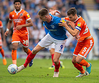 Shrewsbury Town's Matthew Sadler (right) vies for possession with Portsmouth's Oliver Hawkins (right) <br /> <br /> Photographer David Horton/CameraSport<br /> <br /> The EFL Sky Bet League One - Portsmouth v Shrewsbury Town - Saturday September 8th 2018 - Fratton Park - Portsmouth<br /> <br /> World Copyright &copy; 2018 CameraSport. All rights reserved. 43 Linden Ave. Countesthorpe. Leicester. England. LE8 5PG - Tel: +44 (0) 116 277 4147 - admin@camerasport.com - www.camerasport.com