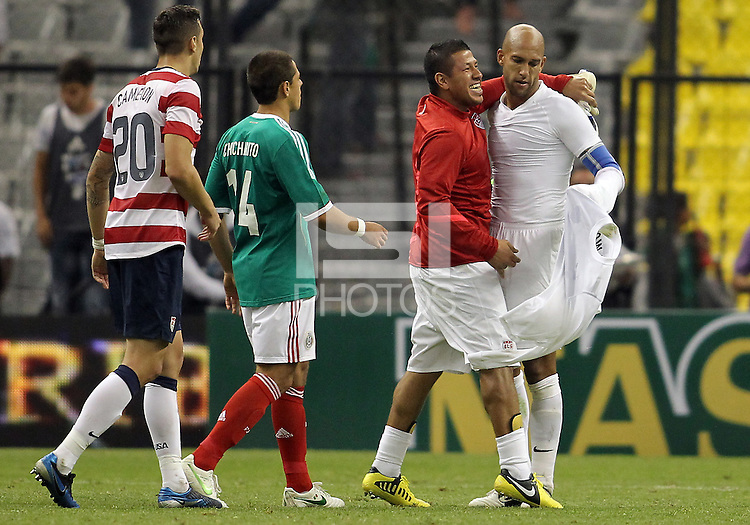 MEXICO CITY, MEXICO - AUGUST 15, 2012:  Geoff Cameron (20), Nick Rimando, Tim Howard (1) of the USA MNT with Javier (Chicharito) Hernandez (14) of  Mexico at the end of an international friendly match at Azteca Stadium, in Mexico City, Mexico on August 15. USA won 1-0.