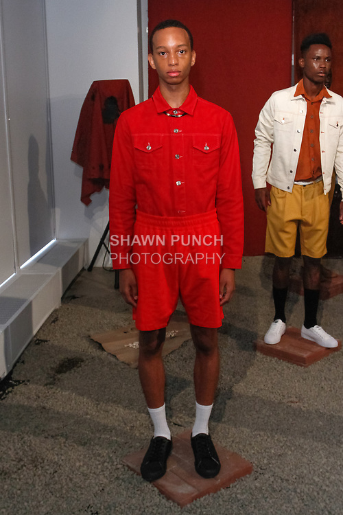 Model poses in an outfit from the Head Of State+ Spring Summer 2018 collection, for New York Mens Day at Dune Studios on July 10, 2017; duing New York Fashion Week: Mens Spring Summer 2018.