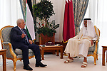 Palestinian President Mahmoud Abbas meets with Emir of the State of Qatar Sheikh Tamim bin Hamad Al Thani, in Doha, on December 16, 2017. Photo by Thaer Ganaim