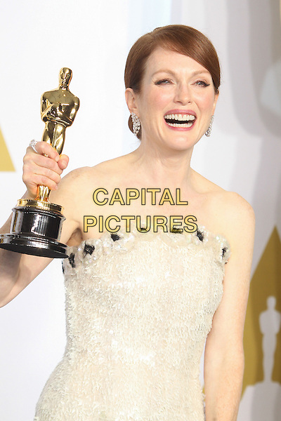 HOLLYWOOD, CA - FEBRUARY 22: Julianne Moore attending The 87th Annual Academy Awards - Press Room held at the Dolby Theatre on February 22nd, 2015. <br /> CAP/MPI/UPA/FS<br /> &copy;FS/UPA/MPI/Capital Pictures Oscars