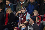 A home fan taking a sip of a drink during the second-half as Burnley hosted Everton in an English Premier League fixture at Turf Moor. Founded in 1882, Burnley played their first match at the ground on 17 February 1883 and it has been their home ever since. The visitors won the match 5-1, watched by a crowd of 21,484.