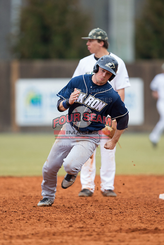 Daulton Mosbarger (4) of the Akron Zips hustles towards third base against the Charlotte 49ers at Hayes Stadium on February 22, 2015 in Charlotte, North Carolina.  The Zips defeated the 49ers 5-4.  (Brian Westerholt/Four Seam Images)