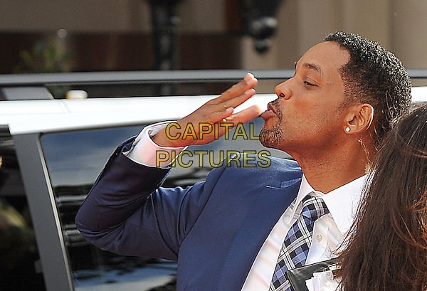 "WILL SMITH.The Gala Premiere of ""The Karate Kid"", Odeon Leicester Square, London, England, UK..15th July 2010.half length blue tie white shirt goatee facial hair tartan plaid checked check profile hand blowing kiss .CAP/BEL.©Tom Belcher/Capital Pictures."
