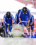 19 December 2010: Alexander Kasjanov leads his 4-Man Bobsled team in the push-off, taking 5th place for Russia at the Viessmann FIBT World Cup Championships on Mount Van Hoevenberg in Lake Placid, New York, USA. Mandatory Credit: Ed Wolfstein Photo