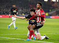 Manchester United's Harry Maguire battles with Sheffield United's Lys Mousset <br /> <br /> Photographer Alex Dodd/CameraSport<br /> <br /> The Premier League - Sheffield United v Manchester United - Sunday 24th November 2019 - Bramall Lane - Sheffield<br /> <br /> World Copyright © 2019 CameraSport. All rights reserved. 43 Linden Ave. Countesthorpe. Leicester. England. LE8 5PG - Tel: +44 (0) 116 277 4147 - admin@camerasport.com - www.camerasport.com