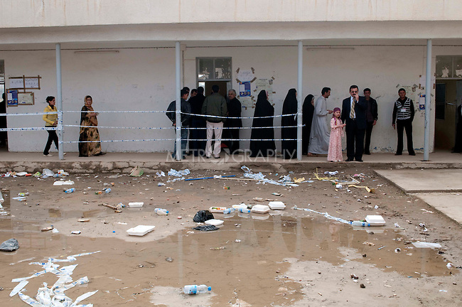 KIRKUK, IRAQ: A polling station in a town on the outskirts of the city of Kirkuk...Residents of the city of Kirkuk vote for the first time.  Because of violence in the ethnically mixed city, Kirkuk was excluded from the 2005 elections...Photo by Kamaran Najm/Metrography