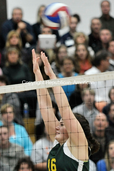 GLASTONBURY, CT-16 November 2012-111612EC07-- Holy Cross' Meghan Leger attempts a block as the team plays against Glastonbury for the Class S title Friday night.  The Crusaders fell 3-0 (25-7, 25-14, 25-8).  Erin Covey Republican-American