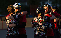 17 AUG 2014 - LONDON, GBR - Mondial players (in red and black) are congratulated on their victory in the 2014 London Open Bike Polo tournament final by players from Triple Jay (in black) at Highbury Fields in London, Great Britain (PHOTO COPYRIGHT © 2014 NIGEL FARROW, ALL RIGHTS RESERVED)