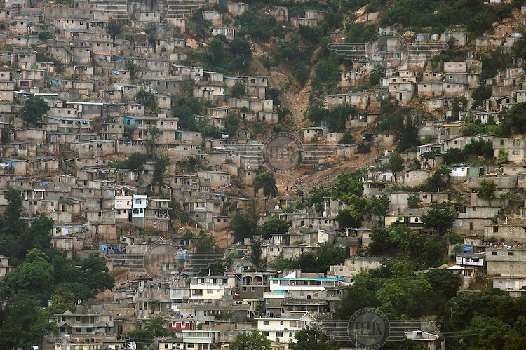 Shanty housing in a hillside slum.Photo: Dermot Tatlow/Panos Pictures/Felix Features