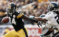 PITTSBURGH, PA - OCTOBER 16:  Rashard Mendenhall #34 of the Pittsburgh Steelers runs with the ball past the Jacksonville Jaguars defense during the game on October 16, 2011 at Heinz Field in Pittsburgh, Pennsylvania.  (Photo by Jared Wickerham/Getty Images)