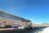 Oct. 27, 2012; Las Vegas, NV, USA: NHRA top fuel driver Steve Torrence (right) races alongside T.J. Zizzo during qualifying for the Big O Tires Nationals at The Strip in Las Vegas. Mandatory Credit: Mark J. Rebilas-