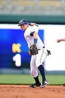 Montgomery Biscuits shortstop Jake Hager (2) attempts to turn a double play during a game against the Mississippi Braves on April 22, 2014 at Riverwalk Stadium in Montgomery, Alabama.  Mississippi defeated Montgomery 6-2.  (Mike Janes/Four Seam Images)