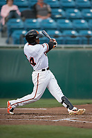 San Jose Giants right fielder Sandro Fabian (54) follows through on his swing during a California League game against the Modesto Nuts at San Jose Municipal Stadium on May 15, 2018 in San Jose, California. Modesto defeated San Jose 7-5. (Zachary Lucy/Four Seam Images)
