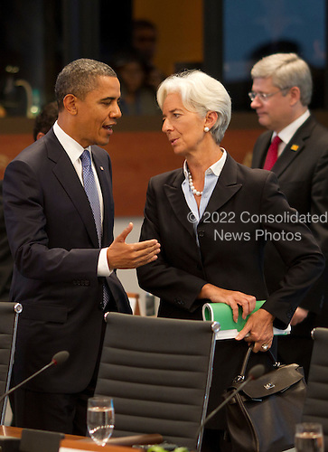 United States President Barack Obama talks with International Monetary Fund Chief Christine Lagarde at the Opening plenary session of the Asia-Pacific Economic Cooperation (APEC) summit at the J.W. Marriott Hotel in Honolulu, Hawaii on Sunday, November 13, 2011..Credit: Kent Nishimura / Pool via CNP