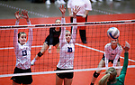 November 22, 2019; Rapid City, SD, USA; Sydney Tims #13 and Caitlyn Pruis #10 of Sioux Falls Christian ready their block against Miller at the 2019 South Dakota State Volleyball Championships at the Rushmore Plaza Civic Center in Rapid City, S.D. (Richard Carlson/Inertia)