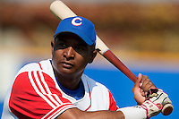 27 September 2009: Ariel Borrero of Cuba warms up prior to the 2009 Baseball World Cup gold medal game won 10-5 by Team USA over Cuba, in Nettuno, Italy.